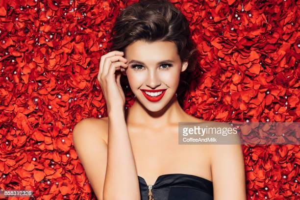 portrait of a nice looking woman - red roses stock pictures, royalty-free photos & images