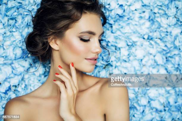 portrait of a nice looking woman - beautiful women stock pictures, royalty-free photos & images