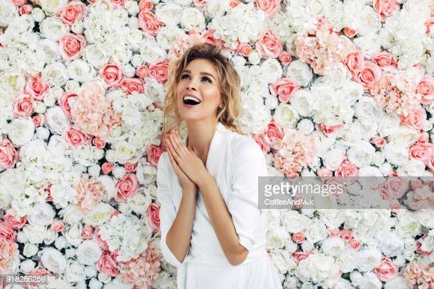 portrait of a nice looking woman - pink flowers stock pictures, royalty-free photos & images
