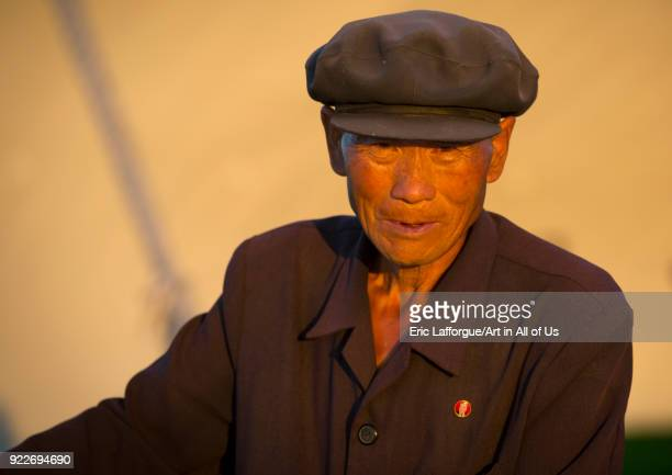 Portrait of a North Korean man with a cap Kangwon Province Wonsan North Korea on September 10 2012 in Wonsan North Korea