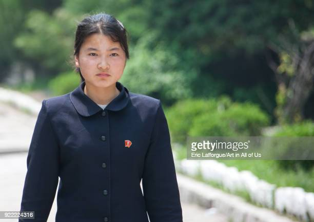 Portrait of a North Korean young woman in the street North Hwanghae Province Kaesong North Korea on May 19 2009 in Kaesong North Korea