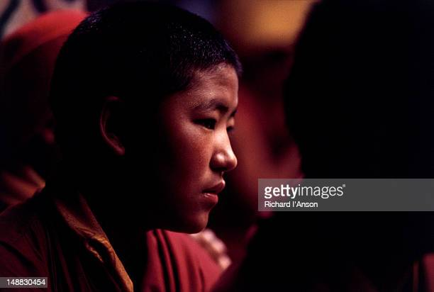 portrait of a novice monk at the mani rimdu festival at chiwang gompa (monastery). - mani rimdu festival stock pictures, royalty-free photos & images