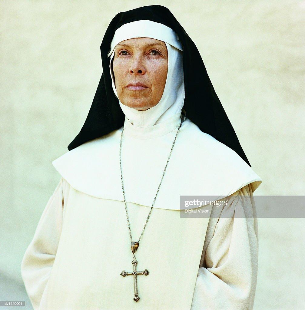 Portrait of a Nun Wearing a Crucifix : Stock Photo