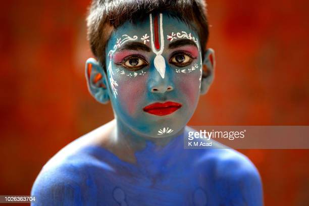 Portrait of a painted boy takes part in a procession during celebrations Janmashtami or Lord Krishnas Birthday in Dhaka Bangladesh According to Hindu...