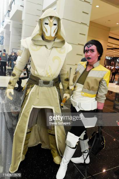 Portrait of a pair of attendees dressed as Star Wars-related characters at attend the Star Wars Celebration event at Wintrust Arena, Chicago,...