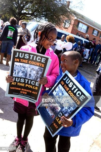 Portrait of a pair of children as they pose with signs during the Good Friday Peace March in the Englewood neighborhood Chicago Illinois 2017 Their...