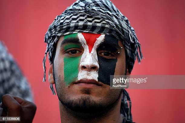 Portrait of a Palestinian with the Palestinian flag painted on his face Athens Greece May 15 2011