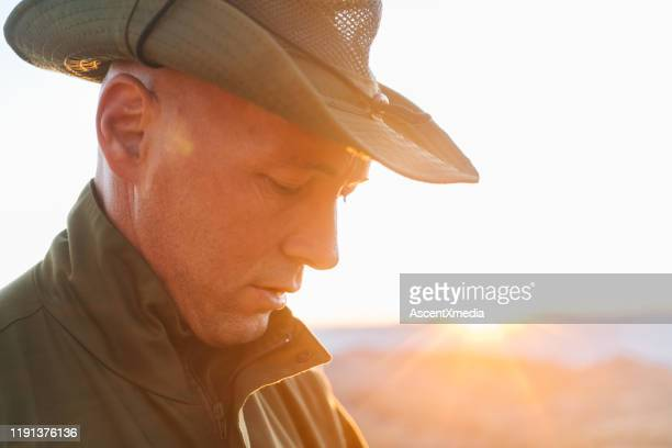 portrait of a park guide in the mountains at sunrise - khaki green stock pictures, royalty-free photos & images