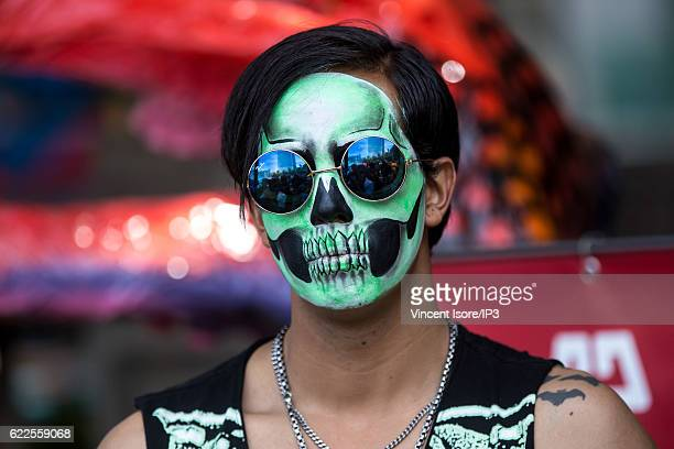 Portrait of a participant who wears a colorful makeup and parades through the streets during the 'Catrinas Parade' a joyful annual event celebrated...