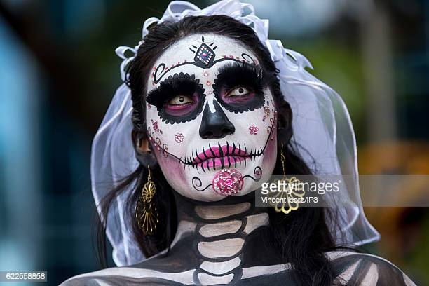 Portrait of a participant who wears a skeleton makeup and parades through the streets during the 'Catrinas Parade' a joyful annual event celebrated...
