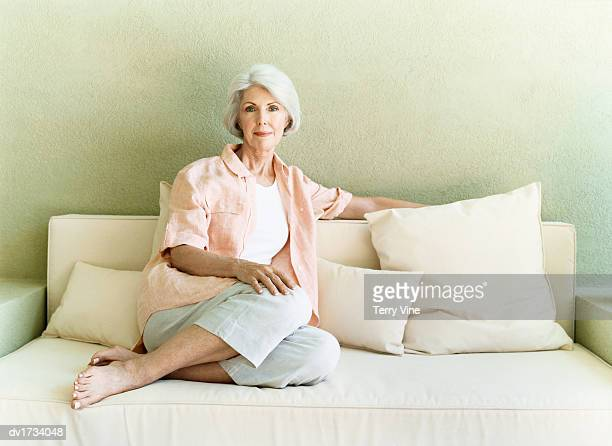 Portrait of a Pensive Looking Senior Woman Sitting on a Sofa