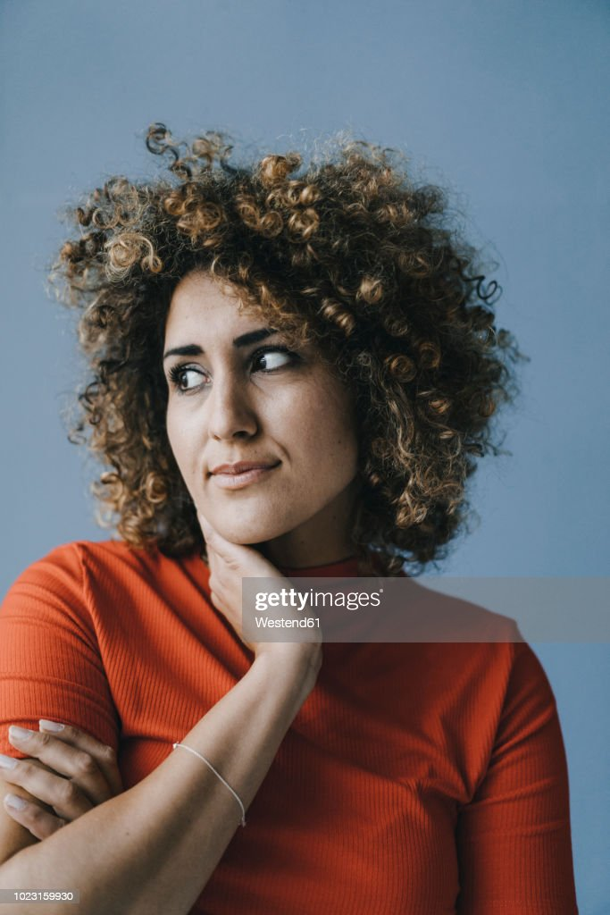 Portrait of a pensive woman with hand on chin : Stock Photo