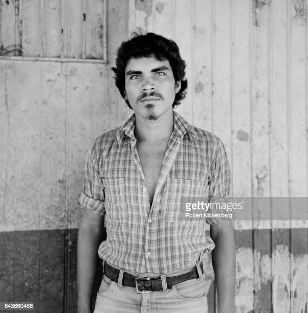 A portrait of a People's Liberation Forces guerrilla fighter as he stands in front of a building occupied during an attack in Cinquera El Salvador...