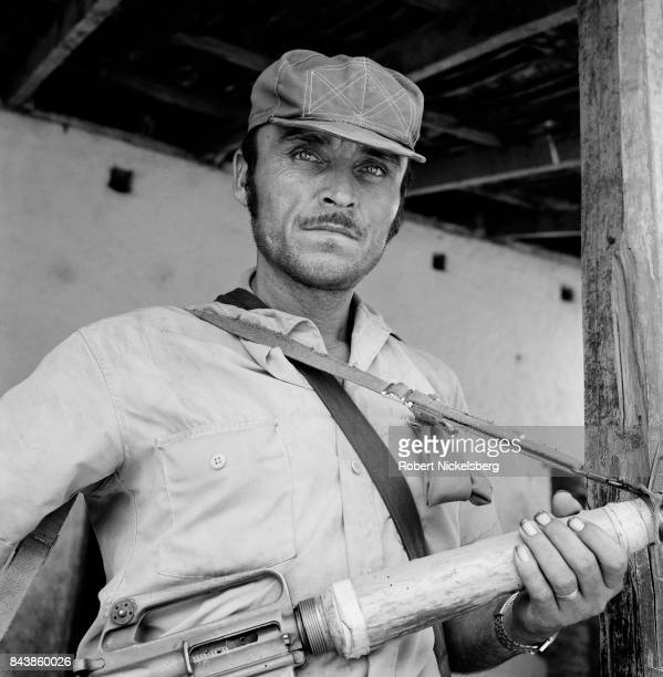 Portrait of a People's Liberation Forces guerrilla fighter as he sits in front of a building occupied during an attack in Cinquera, El Salvador, May...