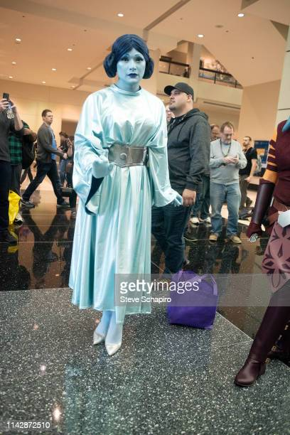 Portrait of a person dressed as a hologram of 'Princess Leia' at the Star Wars Celebration event at Wintrust Arena, Chicago, Illinois, April 13, 2019.