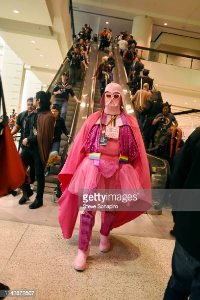 Portrait of a person dressed as a pink version of 'Darth Vader' the Star Wars Celebration event at Wintrust Arena, Chicago, Illinois, April 13, 2019.