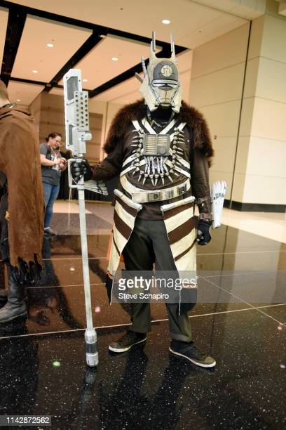 Portrait of a person dressed as 'Enfys Nest' at the Star Wars Celebration event at Wintrust Arena, Chicago, Illinois, April 13, 2019.