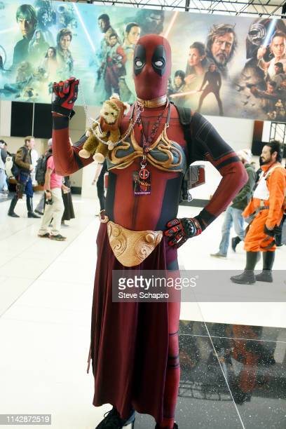 Portrait of a person dressed as the character 'Dead Pool' in a 'Princess Leia' 'slave' costume at the Star Wars Celebration event at Wintrust Arena,...