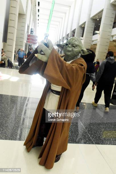 Portrait of a person dressed as 'Yoda' at the Star Wars Celebration event at Wintrust Arena, Chicago, Illinois, April 13, 2019.