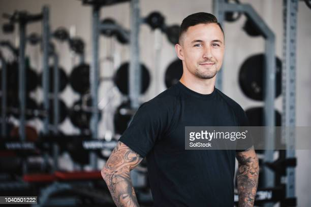 portrait of a personal trainer in the gym - serving sport stock pictures, royalty-free photos & images
