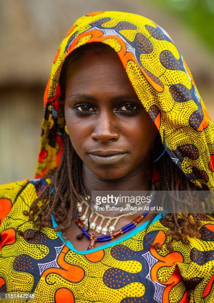 Portrait of a Peul tribe young woman with colorful clothes Savanes district Boundiali Ivory Coast on May 3 2019 in Boundiali Ivory Coast