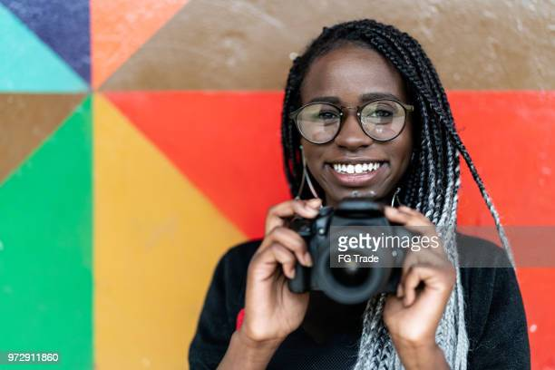 portrait of a photographer smiling with colorful background - artist stock pictures, royalty-free photos & images