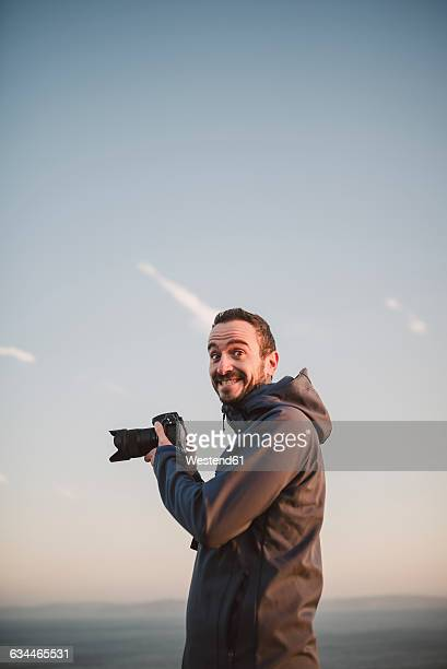 Portrait of a photographer with funny expression