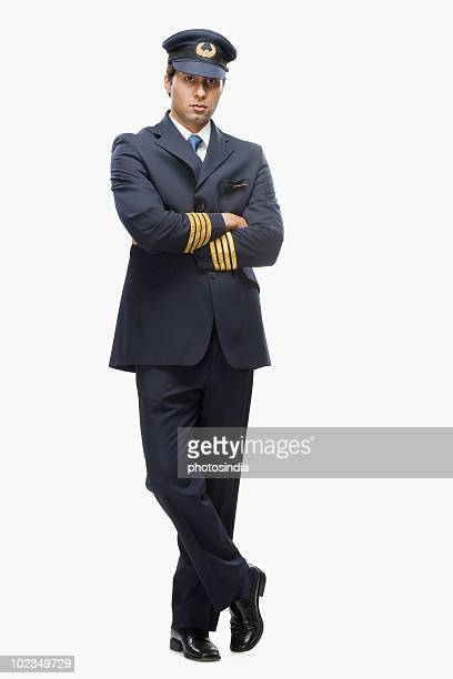 portrait of a pilot with his arms crossed - uniform cap stock pictures, royalty-free photos & images