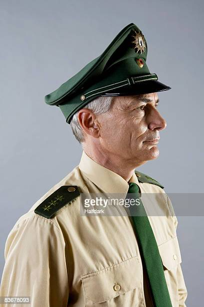 portrait of a police officer - uniform cap stock pictures, royalty-free photos & images