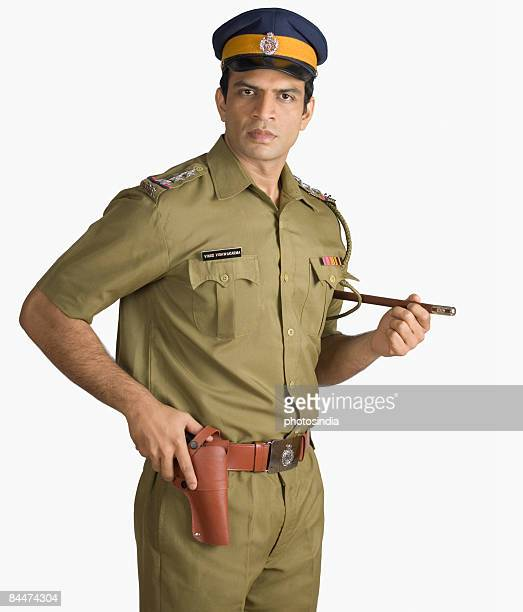portrait of a policeman holding a handgun - police force stock pictures, royalty-free photos & images
