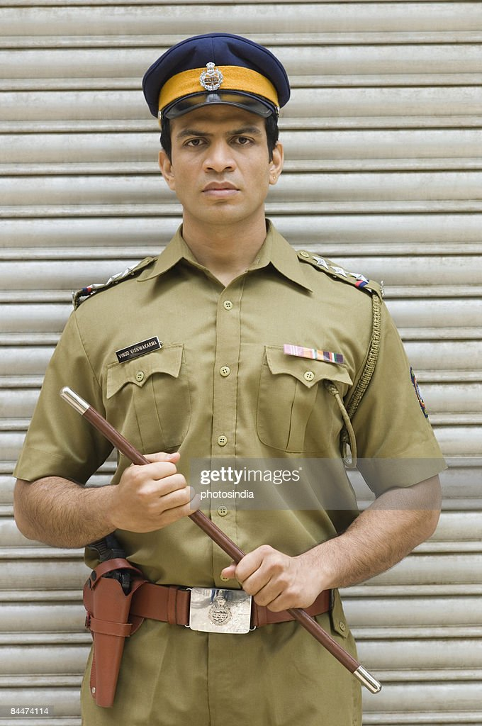 Portrait Of A Policeman Holding A Nightstick Stock Photo ...