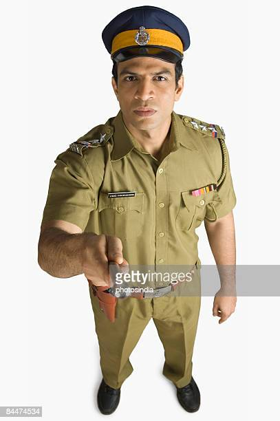 Portrait of a policeman pointing forward with a nightstick