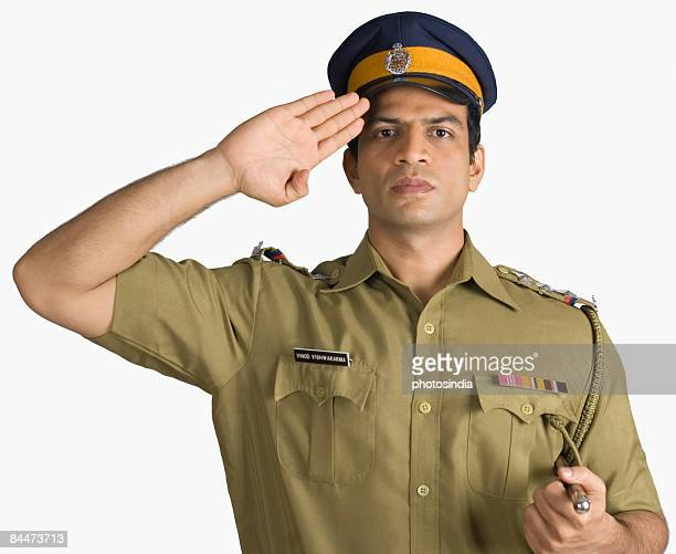 Portrait of a policeman saluting