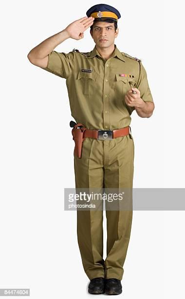 Portrait of a policeman saluting