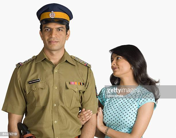 Portrait of a policeman standing with a young woman