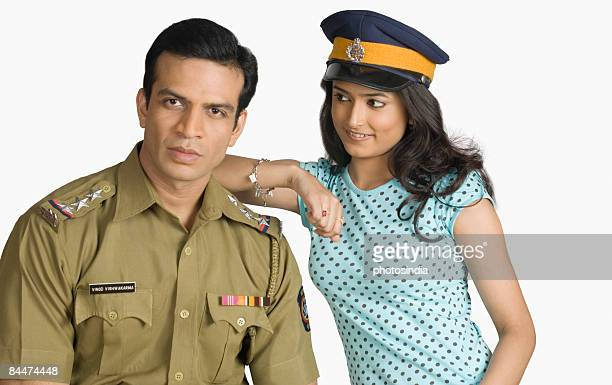 Portrait of a policeman with a young woman standing beside him