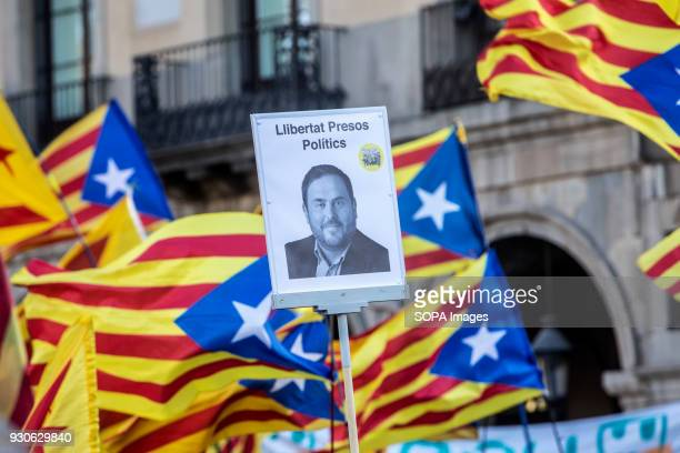A portrait of a political prisoner seen with Catalonia independence flag during the demonstration Tens of thousands of Catalans attended a...