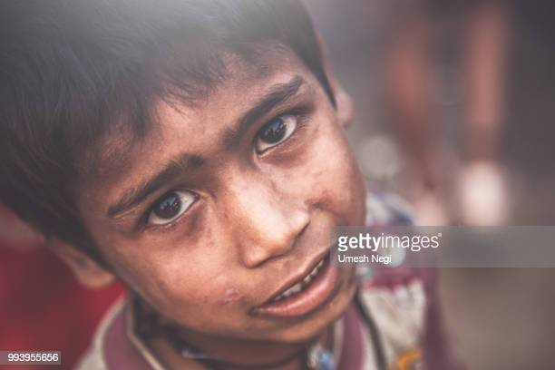 a portrait of a poor child from india - orphan stock pictures, royalty-free photos & images