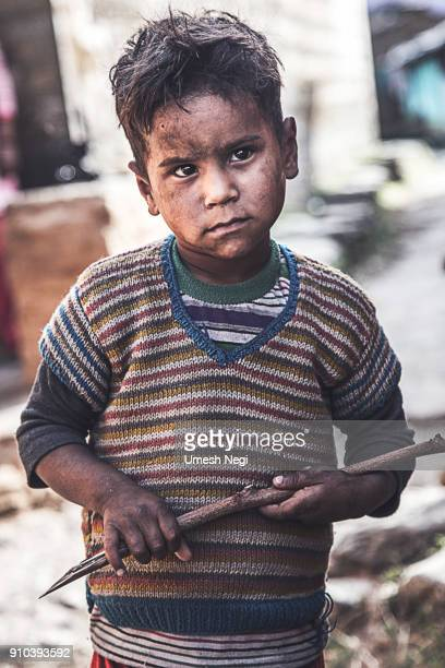 Portrait of a poor young Indian village boy