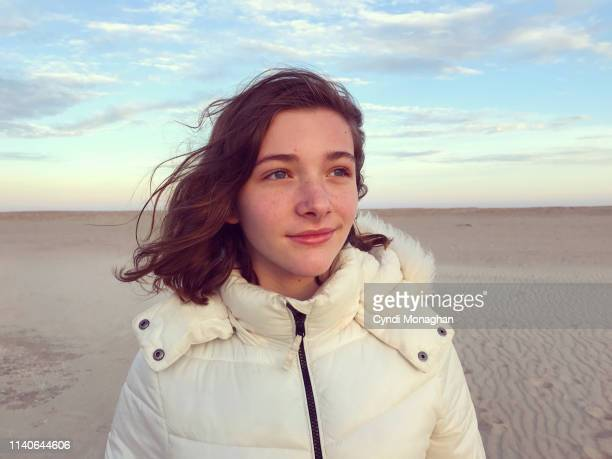 portrait of a pre teen girl standing on a winter beach - naughty america stock pictures, royalty-free photos & images
