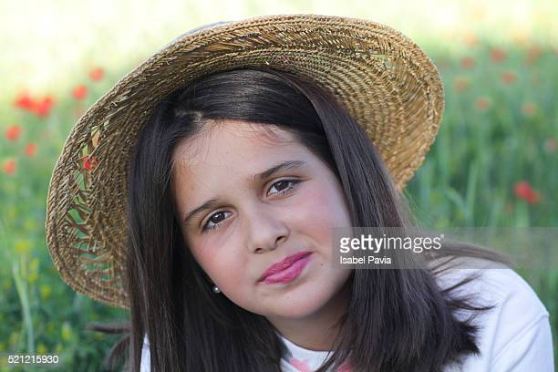 Portrait of a pretty girl with big sunhat