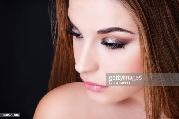 Portrait of a pretty girl with silver makeup