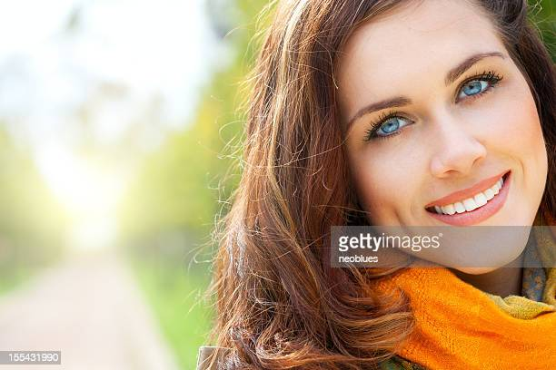 Portrait of a pretty woman wearing a scarf