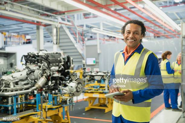 portrait of a production line surveyor - motor vehicle stock photos and pictures