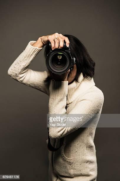 Portrait of a professional female photographer