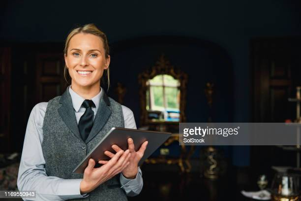 portrait of a professional hotel employee - hotel stock pictures, royalty-free photos & images