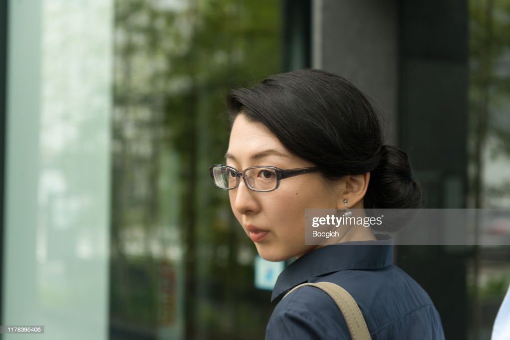Portrait of a Professional Japanese Woman Working in an Office : Stock Photo