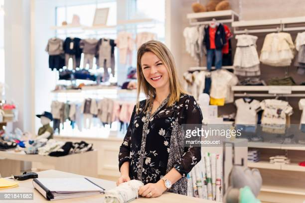"""portrait of a proud woman, children store owner. - """"martine doucet"""" or martinedoucet stock pictures, royalty-free photos & images"""