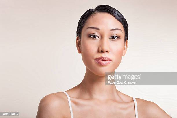 portrait of a proud woman looking at the camera - hair back stock pictures, royalty-free photos & images