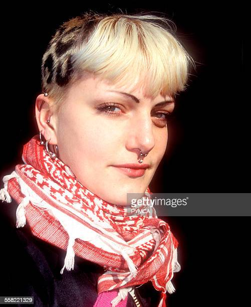 Portrait of a punk girl with a nose piercing wearing an Arabic scarf UK 2006